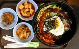 Bibimbap Rice with Egg, Beef and Vegetables with Chopsticks.jpg